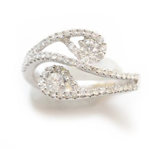 2 Brilliant cut diamonds surrounded by pave set pear shaped collars and a swirl design  D0.64ct