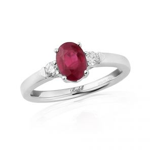 Mesmerising oval cut Ruby beautifully showcased in 18ct White Gold and enhanced by two brilliant cut Diamonds D.16ct R1.25ct