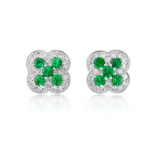 Gorgeous Brilliant cut emerald earrings set in 18ct white gold with a delicate diamond surround.