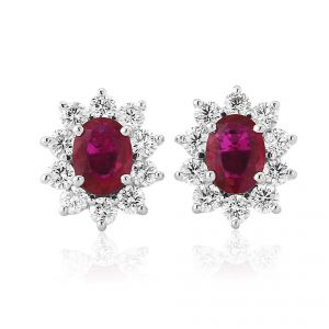 A classic cluster of brilliant cut Diamonds and an oval cut Ruby in a rich 18ct Yellow Gold setting