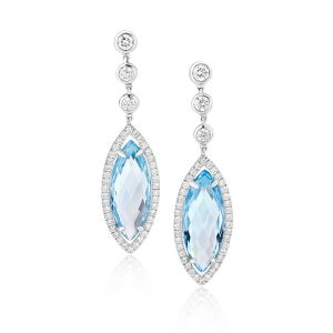 Stunning Marquise shape blue topaz delicately edged with diamonds in 18ct white gold D0.84ct BT9.52ct