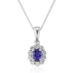 Admire the deep hues of the oval cut Tanzanite surrounded by dazzling round brilliant cut Diamonds in 18ct White Gold T.17 D.12